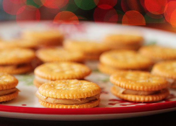 Ritz Cookies — Ritz Crackers stuffed with Peanut Butter dipped in White Chocolate