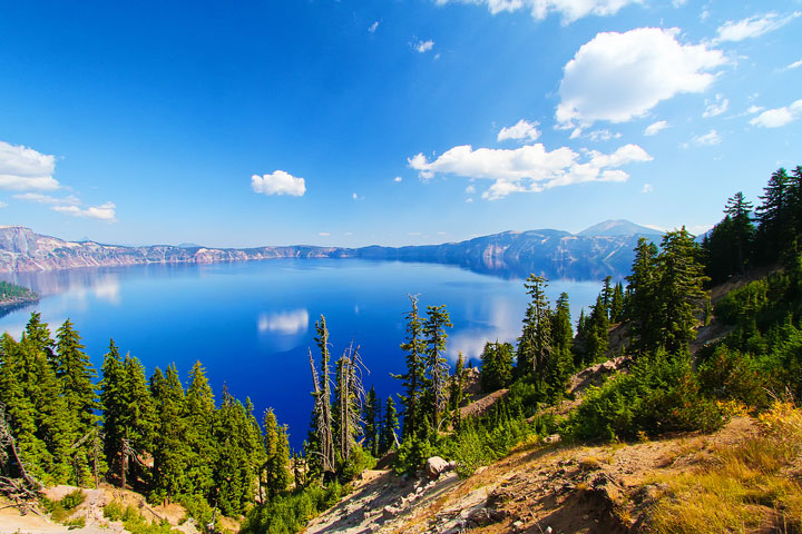{ PHOTOS } Crater Lake, Oregon: Home of the remarkably blue, crystal clear waters of the nation's deepest lake. www.kevinandamanda.com #travel