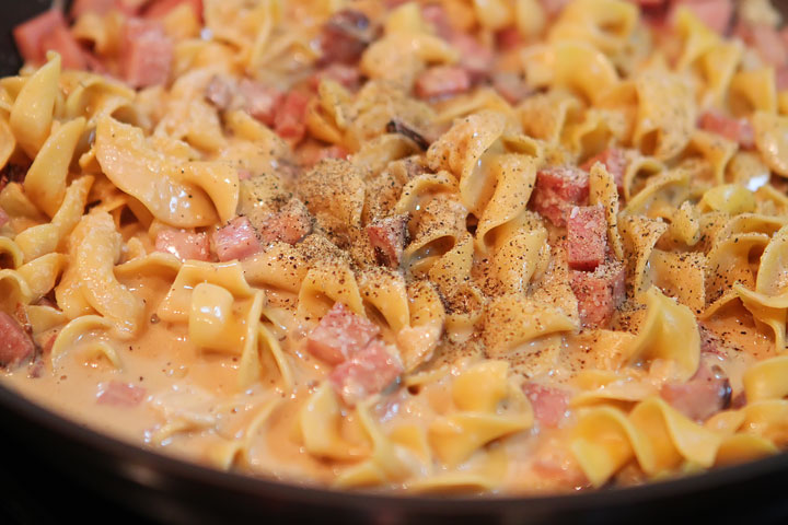 Peas, Ham, and Creamy Noodles -- A perfect, easy one dish skillet dinner, made in less than 15 mins! You even boil the noodles right in the skillet. www.kevinandamanda.com