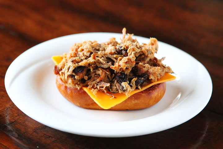 All I can say is WOW! Spicy pulled pork topped with a bright mango-peach salsa, a fried egg and served on a fresh pretzel bun.