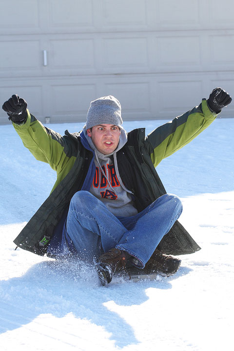 Image of Kevin Sledding in The Snow