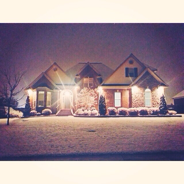 House at night with snow.