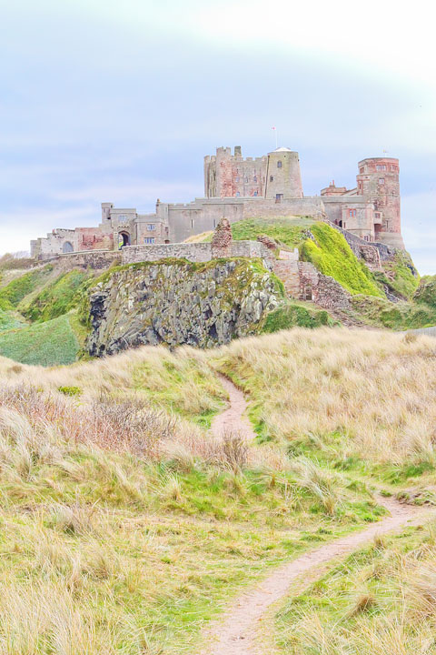 Visit Bamburgh Castle on a castle drive down the coast of Scotland + More Tips for Traveling to Scotland from www.kevinandamanda.com.