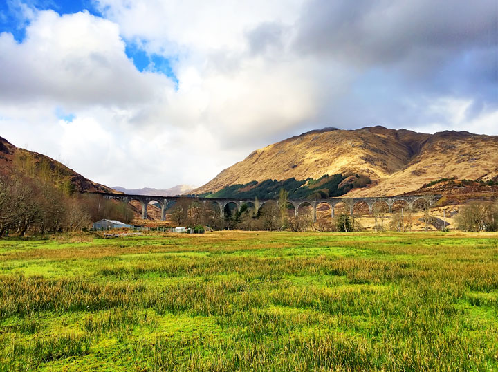 Glenfinnan Viaduct from Harry Potter + Tips for Traveling to Scotland. What to Do, See, & Eat. www.kevinandamanda.com