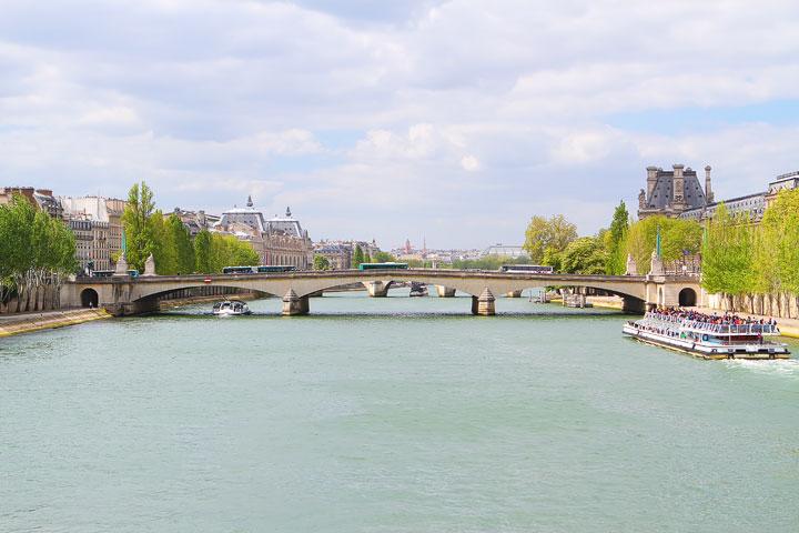 View from Pont des Arts AKA The Love Lock Bridge, Paris. Tips for planning a Paris Vacation. www.kevinandamanda.com #paris #travel #france