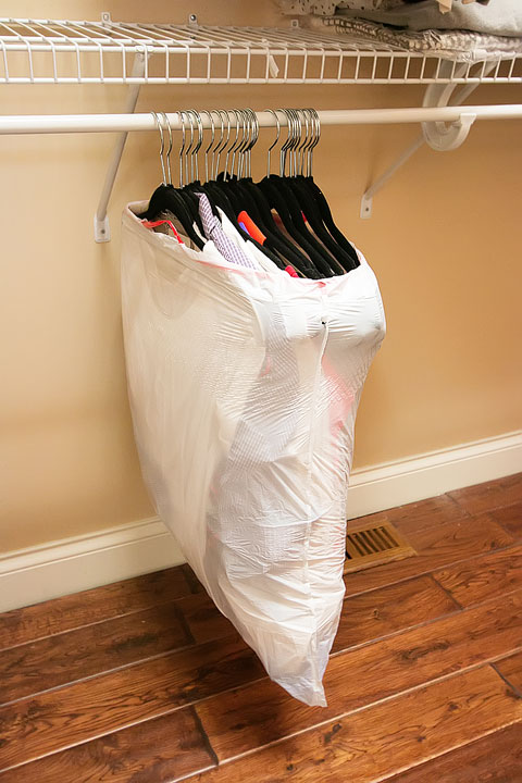 Super easy trick for moving clothes. This way keeps all your clothes on their hangers, then you can just take off the bag when you hang them up again!