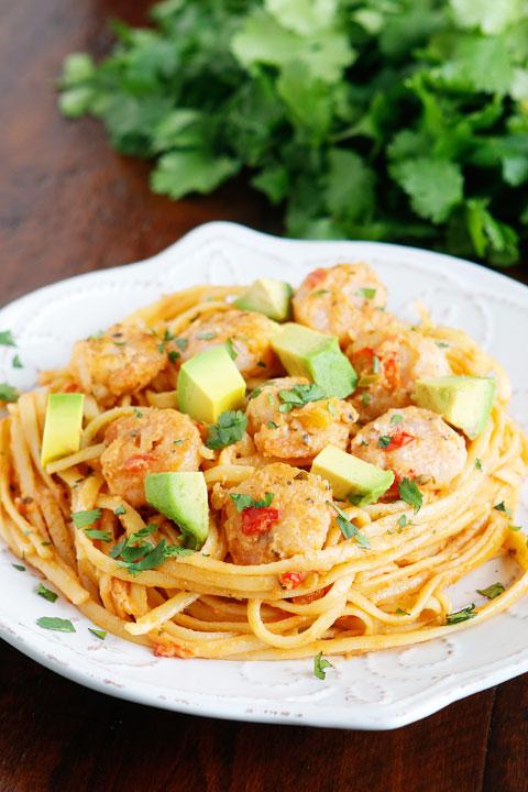 Golden, crunchy shrimp in a zesty Mango-Peach salsa pasta with avocado! Fabulous!!