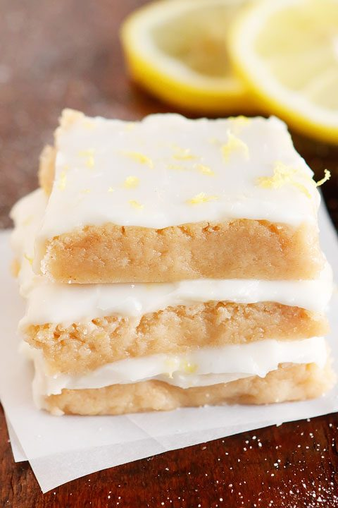 These Brown Butter Frosted Lemon Squares are the perfect lemon treat!! A decadent brown butter lemon shortbread is topped with a sweet lemon glaze. They're soft, chewy, and MELT in your mouth!! I made these for a party and they disappeared off the plate!