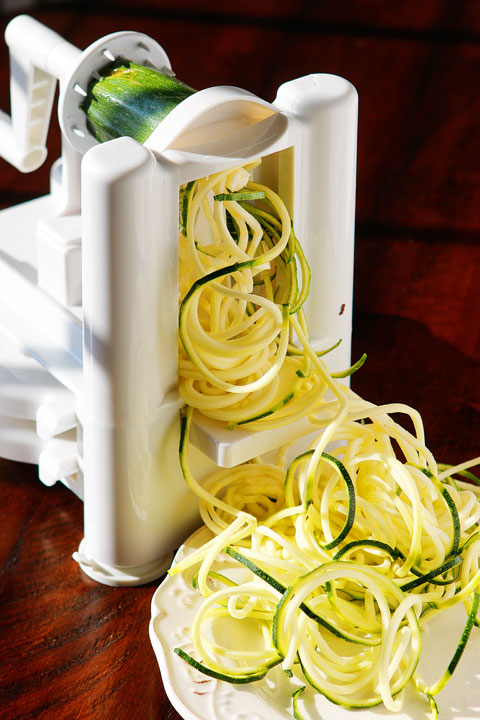 The PERFECT summer recipe!! Sautéed shrimp and red bell peppers poured over a bed of spiralized zucchini and yellow squash. So easy and delicious!