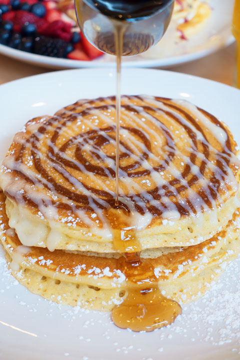 Image of a Cinnamon Bun Pancake from Snooze AM Eatery