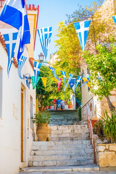 Greek Flags in Plaka neighborhood of Athens Greece