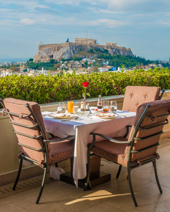 Breakfast view of Acropolis in Athens Greece