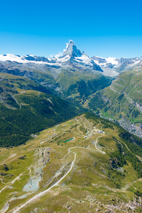 """The most amazing, once-in-a-lifetime experience!! Go paragliding with the most breathtaking, jaw-dropping views EVER with the Matterhorn in the background!!! If you are ever anywhere near Switzerland you HAVE to put paragliding in Zermatt on your bucket list!!!! If you mention """"Kevin & Amanda"""" at FlyZermatt.com you'll get a free T-shirt!! They're super cute too!"""