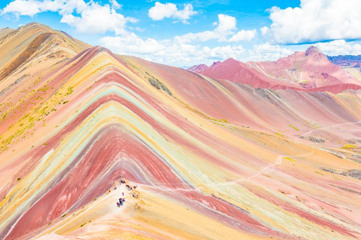 Rainbow Mountain, Peru. Don't go at 3 AM with the tour groups. Sleep in, miss the crowds, and have Rainbow Mountain all to yourself! Read this post for everything you need to know about hiking Rainbow Mountain in Peru.