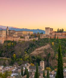 Sunset view of the Alhambra from Mirador San Nicolás in Granada Spain
