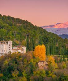 Sunset view from Mirador San Nicolás in Granada Spain