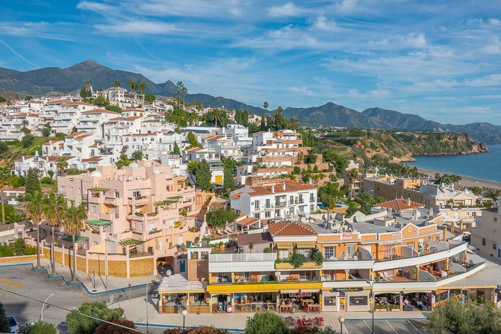 Pink Building with mountain in background in Nerja Spain