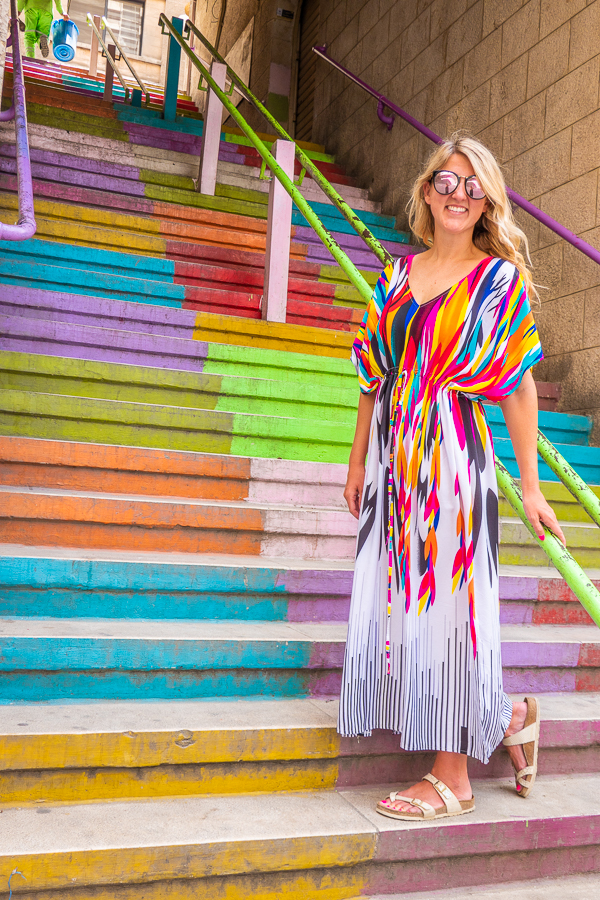 Girl in colorful dress on Rainbow Stairs in Amman Jordan