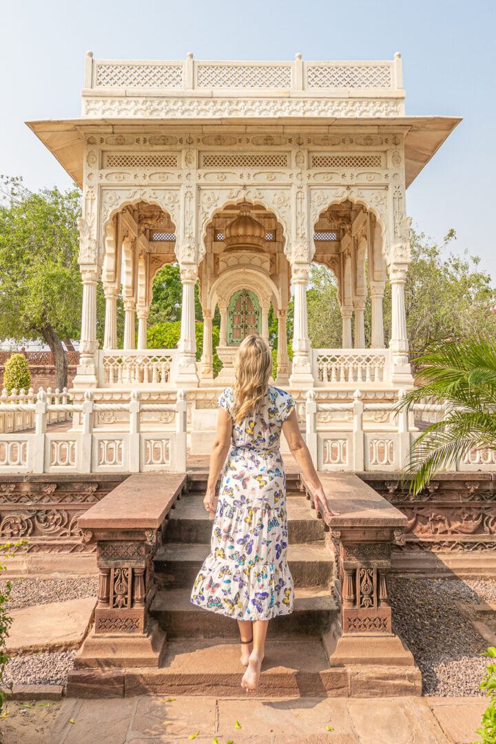 Woman standing in front of a gazeebo in Jodhpur, India