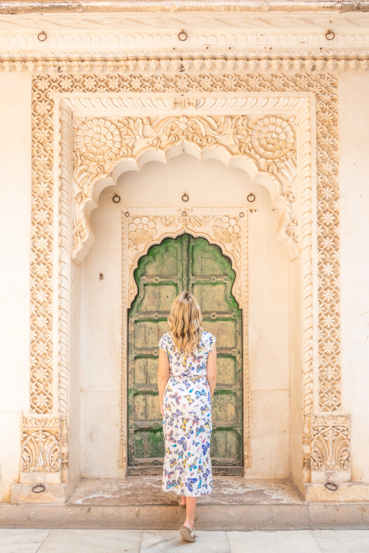 Blonde woman in front of green door at at Merangherang Fort