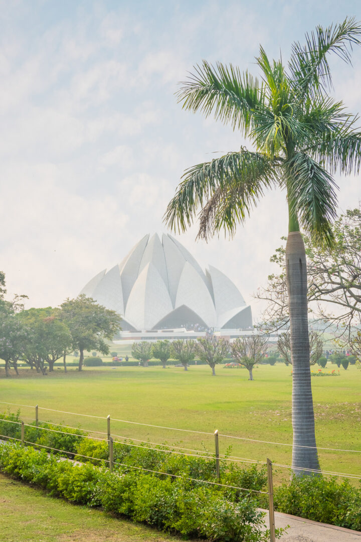 Bahai Temple AKA Lotus Temple with a palm tree
