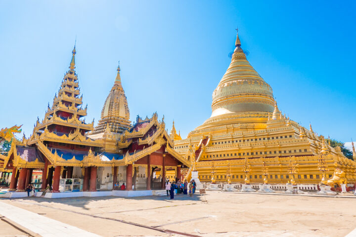 Further back image of the gold plated Shwezigon Pagoda in Bagan, Myanmar.