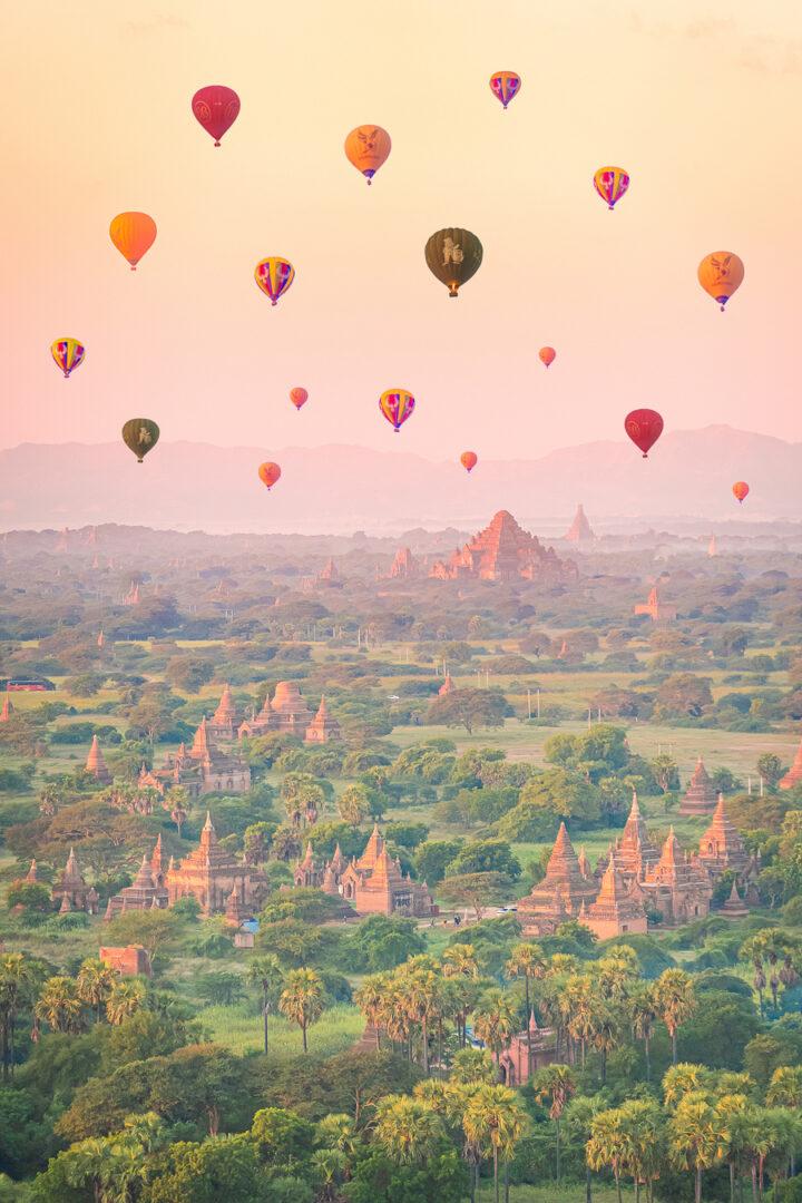 Colorful hot air balloons over Bagan, Myanmar at sunrise.