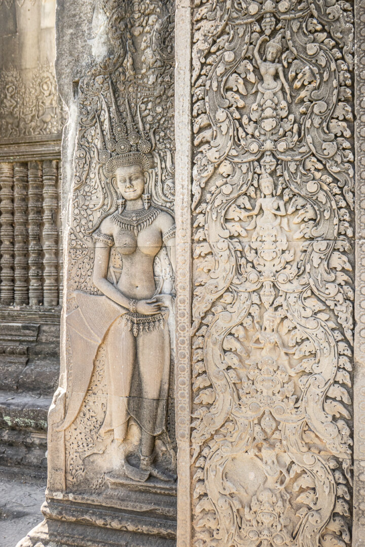 Detailed carvings on the walls of Angkor Wat