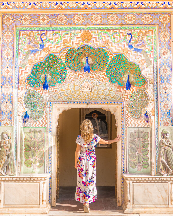 A visitor entering the Peacock Gate at Pritam Niwas Chowk at Jaipur, India.