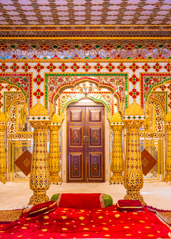 A red and gold room inside one of the palaces in Jaipur, India.