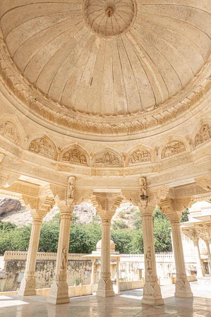 Detailed marble columns outside of The Royal Tombs in Jaipur, India.