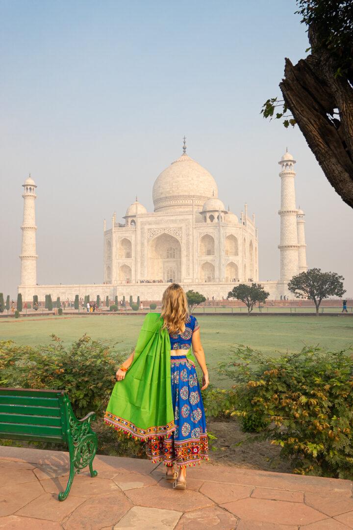 Woman looking towards the Taj Mahal.