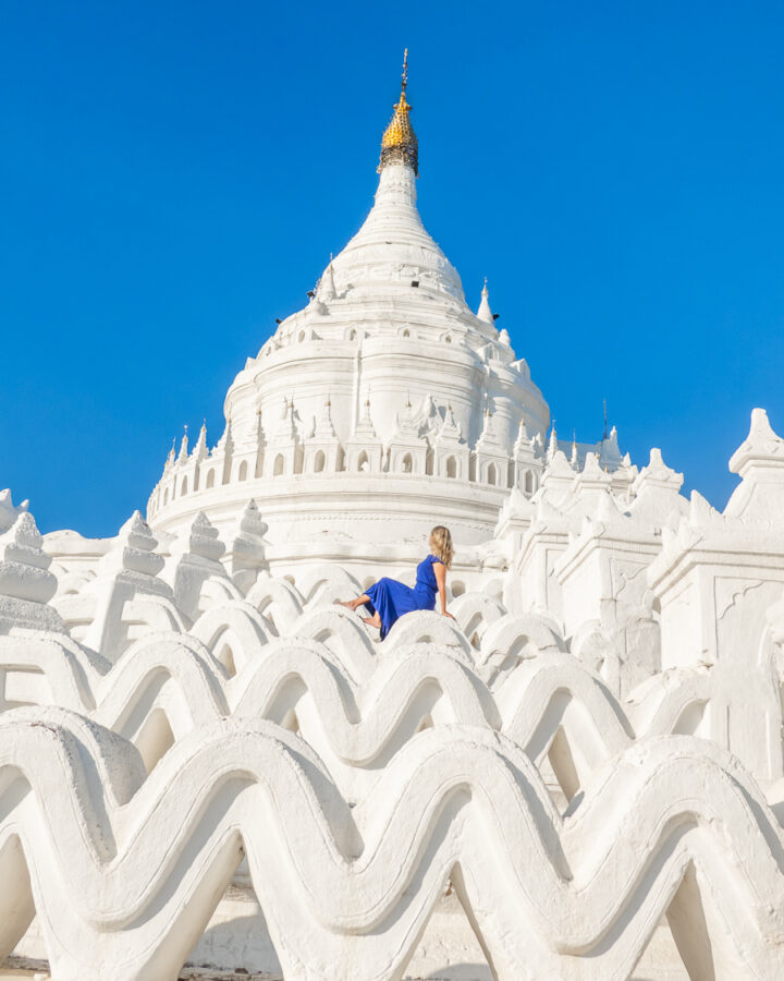 Seated on the white waves at the White Temple in Myanmar.