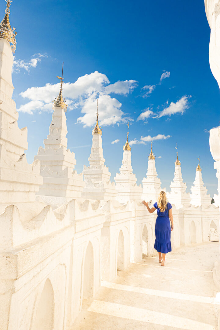 Waking along one of the terraces of the White Temple in Myanmar.
