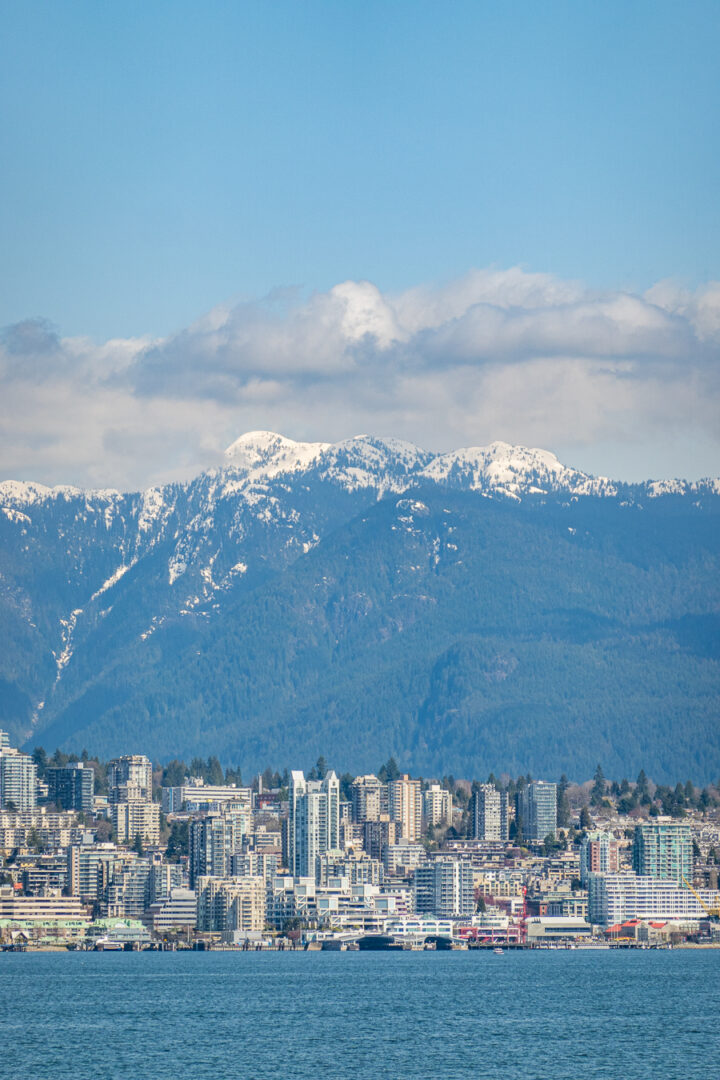 Vancouver city skyline with snow capped mountains in the background