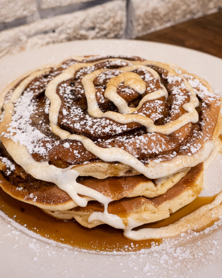stack cinnamon bun pancakes with swirled frosting from Jam Cafe