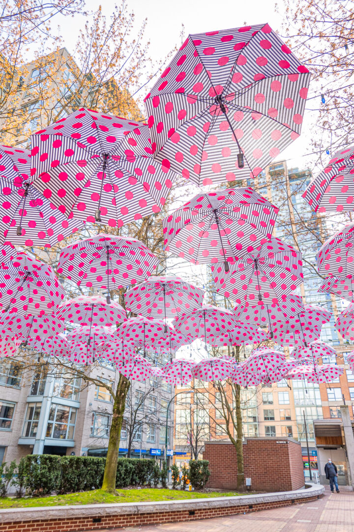 pink polka dot umbrellas hanging from above