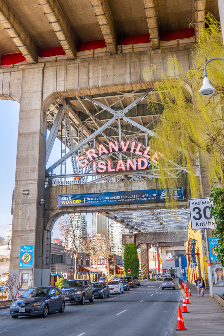 Granville Island Neon Sign under the bridge