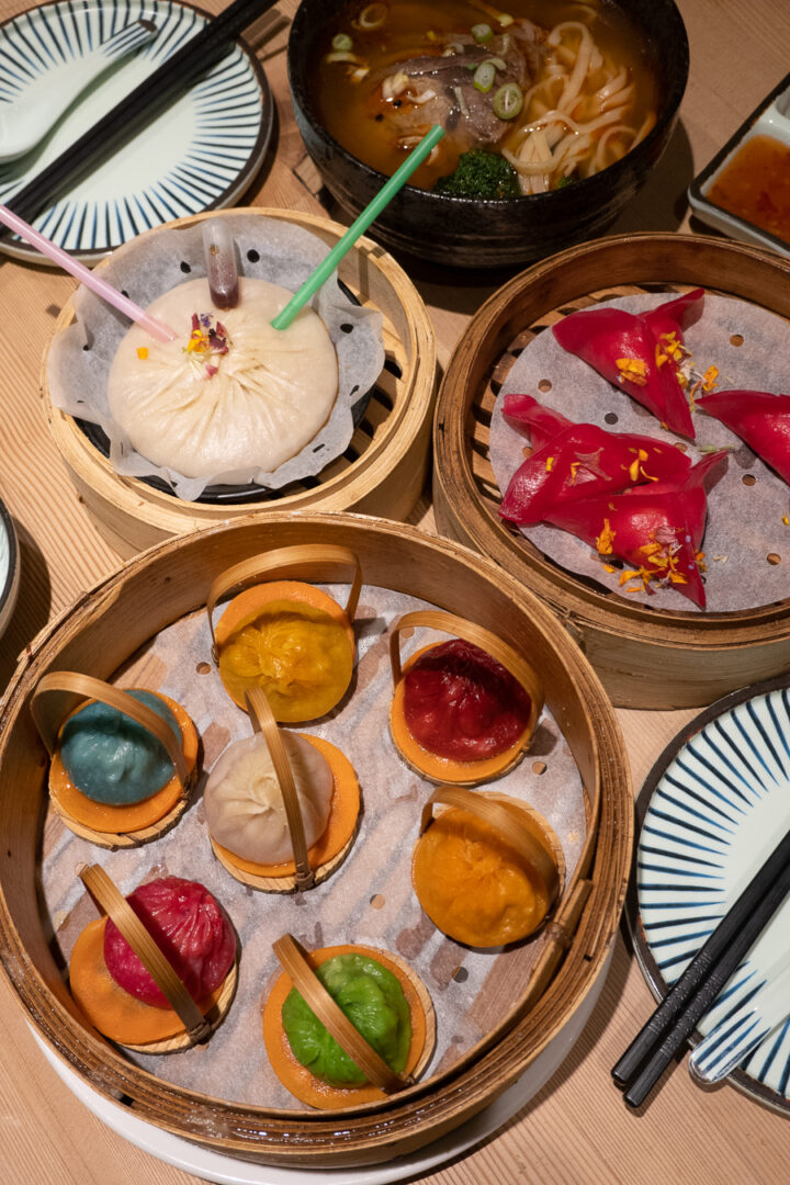 rainbow colored bao buns and dumplings