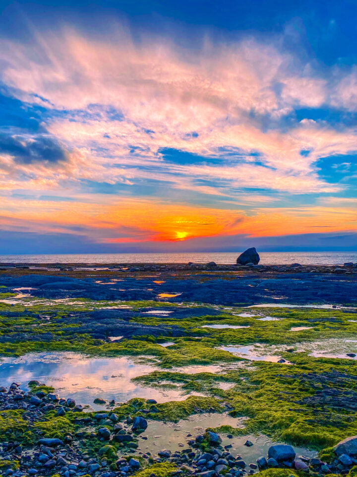 sunset with tide pools on the beach in Gaspesie