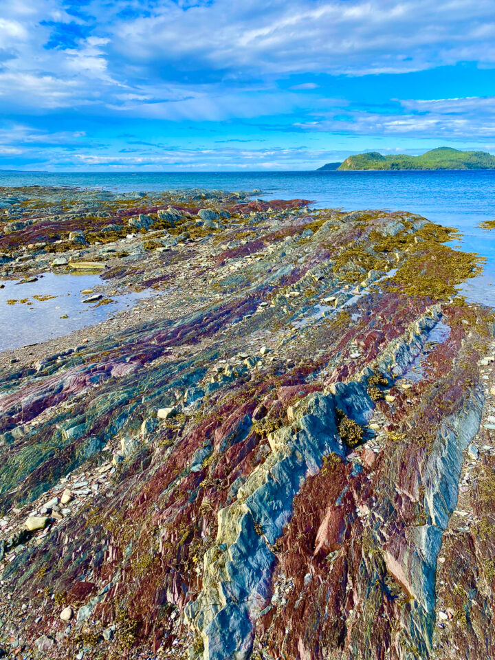 colorful rainbow rock formations on the beach at Bic National Park in Gaspesie