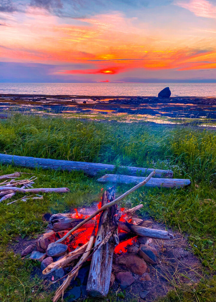 bonfire on the beach at sunset in Gaspesie