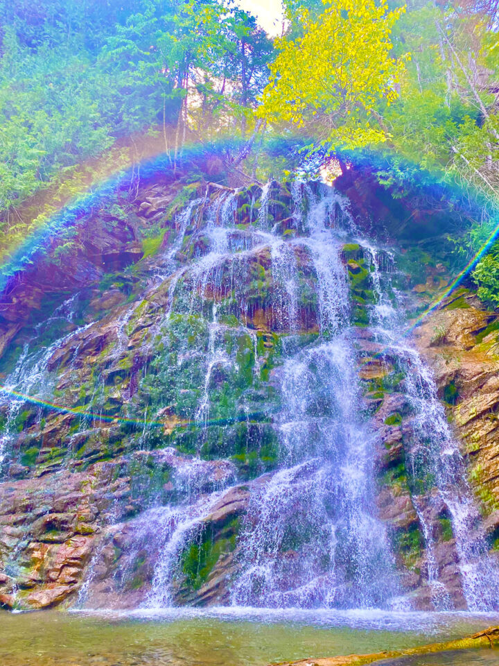 waterfall with rainbow in forillion national park