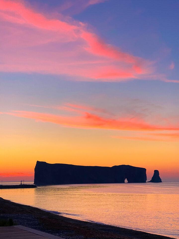 Perce Rock at sunrise with pink sky in Gaspesie